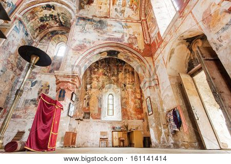 KUTAISI, GEORGIA - SEP 22, 2016: Old frescoes on walls of the empty historical Orthodox monastery Gelati on September 22, 2016. Gelati monastery built in 12th century UNESCO World Heritage Site