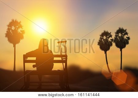 silhouette of disabled on wheelchair or background.day of the disabled person .Concept cripple or disabled .art Plant Dawn View Cloud Calm Card Bright Blue model sea love night alone sky sun.
