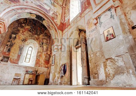 KUTAISI, GEORGIA - SEP 22, 2016: Rustic surface with colorful frescoes on old walls of medieval cathedral Gelati on September 22, 2016. Gelati monastery built in 12th century UNESCO World Heritage Site