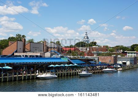 ANNAPOLIS MARYLAND - JULY 11 2016: View of downtown Annapolis Maryland USA waterfront with the dome of the Maryland State House building in the distance on July 11 2016.