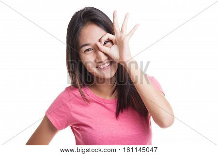 Beautiful Young Asian Woman Show Ok Sign Over Her Eye..