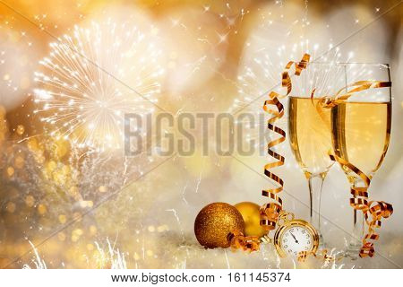 Glasses with champagne against fireworks holiday lights - Celebrating New Year