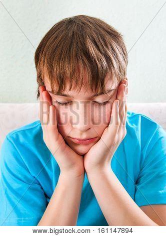 Sad Teenager on the Sofa at the Home