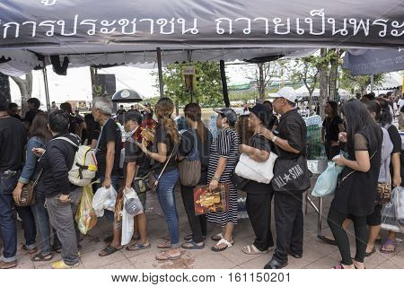 BANGKOK THAILAND - NOV 1 : line up of people for free donation in Sanam Luang while the funeral of king Bhumibol Adulyadej in Grand Palace on november 1 2016