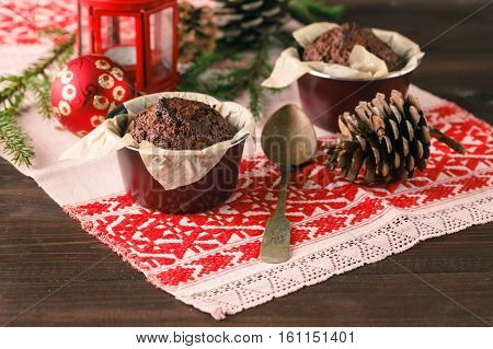 Two Muffins, Chocolate Muffin And Cinnamon Muffins - Sweet Food On A Rustic Wooden Table