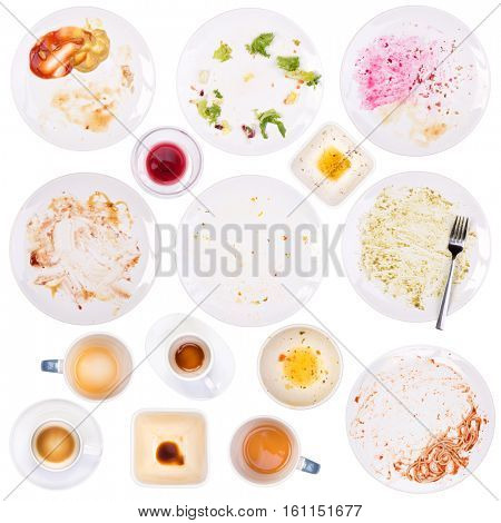 Dirty plates and cups after a meal isolated on white background
