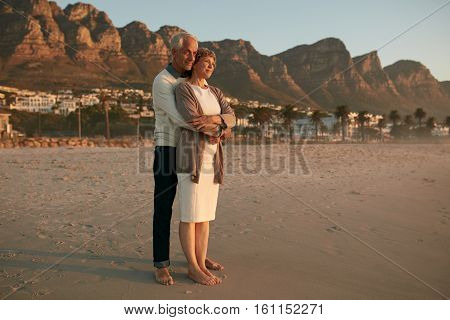 Romantic Senior Couple Embracing On The Sea Shore