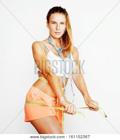 woman measuring waist with tape on knot like a gift, tan isolated close up white background, diet people concept