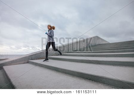 Fitness Woman Running Down On Steps