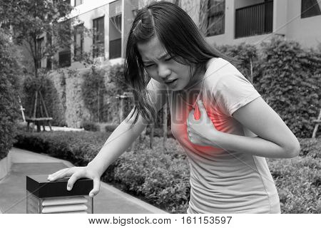 Woman having heart attack Angina Pectoris Myocardial Infarction - black and white concept