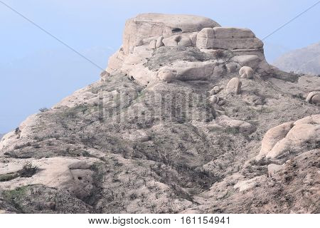 Sandstone rocks with interesting rock formations surrounded by a chaparral woodland taken at the Mormon Rocks in the Cajon Pass, CA