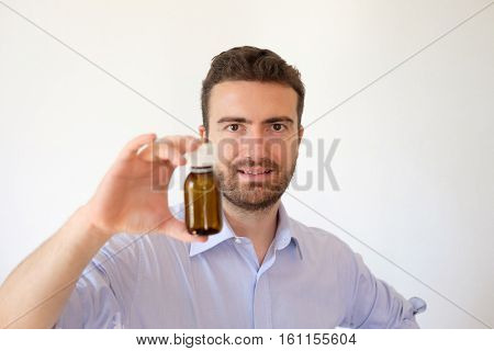 Smiling Man Happy With His Medicines In His Hand