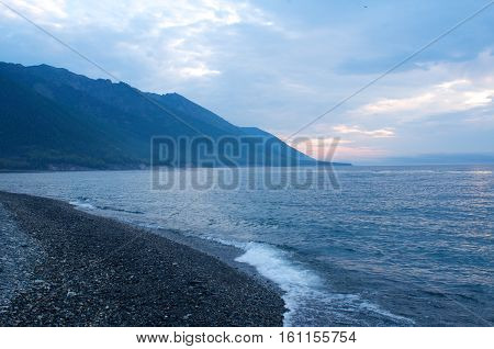 Fog on the Baikal sunrise spring Russia