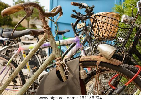 Nostalgic rusty bicycle locked for safety - close-upp