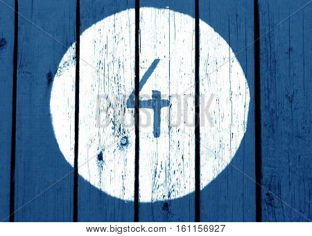 Number Four On Blue Toned Wooden Wall.