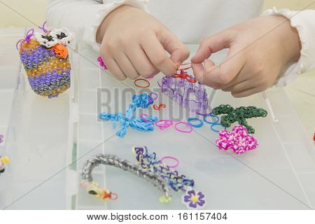 Rainbow loom- Colored rubber bands for weaving accessories.