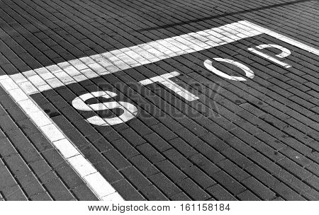 Stop Sign On Pavement In Black And White