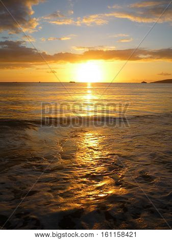 bright sunset reflecting on ocean water at the beach