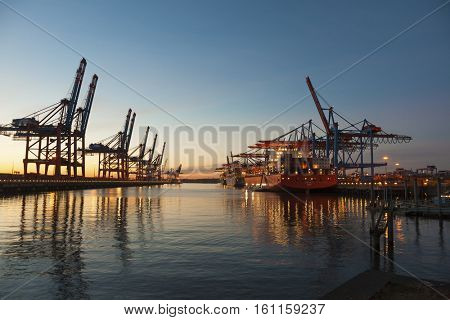 Hamburg, Germany - November 24, 2016: Container terminals at the port of Hamburg, large container ships moored at Burchardkai.