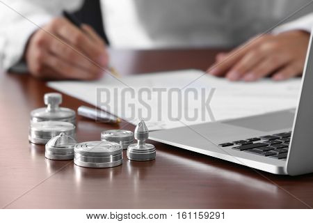 Metal ink pads, stamps and laptop on notary public table