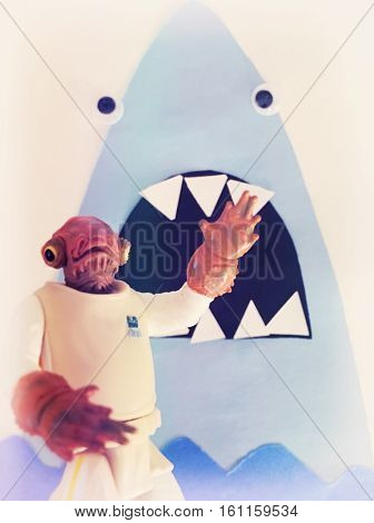 Star Wars Admiral Ackbar action figure being attacked by a construction paper shark- ITS A TRAP!