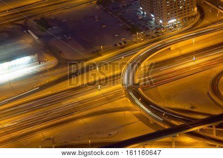 Light streaks on freeways in downtown Dubai (UAE) at night
