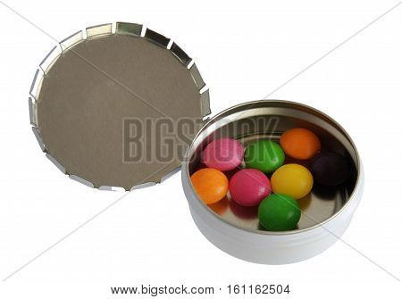 Metallic silver pillbox with color pills isolated on white background