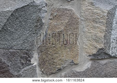 Cold crecked greystone texture. Macro rock background