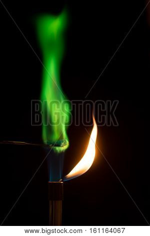 Copper sulphate burning in air with green flame. Bunsen burner with salt combusting in flame showing distinctive color produced
