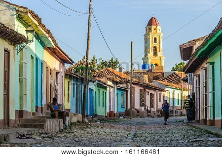 TRINIDAD, CUBA - MARCH 23, 2016: The tower of San Francisco Convent and cobblestone streets in the UNESCO World Heritage old town of Trinidad Cuba