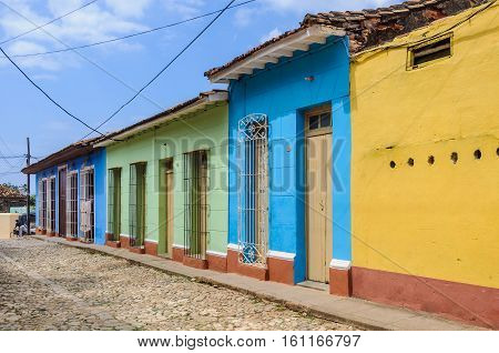 TRINIDAD, CUBA - MARCH 23, 2016: Colorful houses on the cobblestone streets in the UNESCO World Heritage old town of Trinidad Cuba