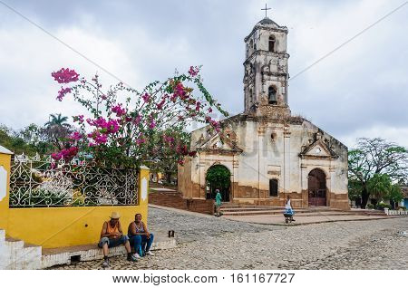 TRINIDAD, CUBA - MARCH 23, 2016: Santa Ana Church on the cobblestone streets in the UNESCO World Heritage old town of Trinidad Cuba