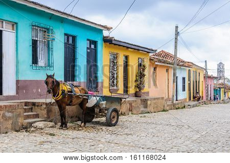 TRINIDAD, CUBA - MARCH 23, 2016: Horse carriage on the cobblestone streets in the UNESCO World Heritage old town of Trinidad Cuba