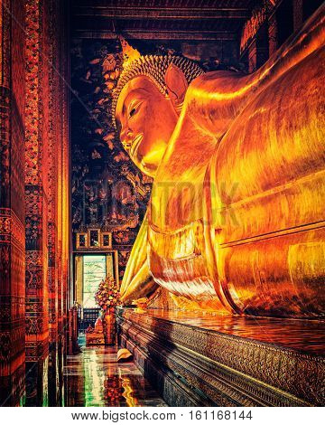 Travel Thailand Buddhism religion - vintage retro effect filtered hipster style image of reclining Buddha gold statue. Wat Pho, Bangkok, Thailand