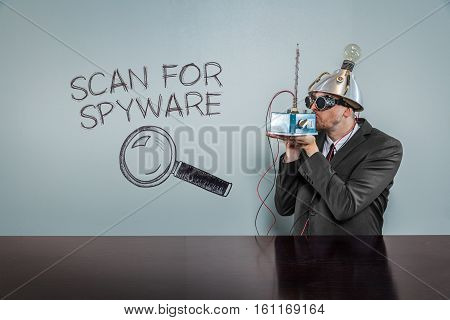 Scan for spyware text with vintage businessman kissing machine