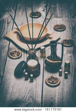 Aromatherapy and relaxation accessories on old wooden planks. Retro style processing