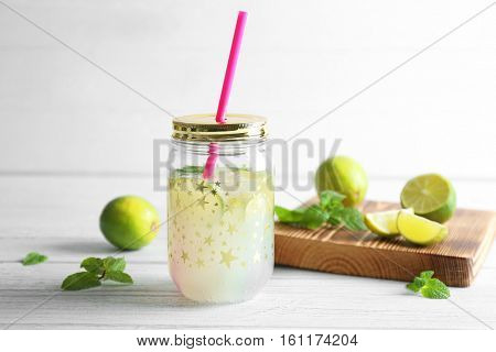 Lime lemonade in mason jar on wooden table