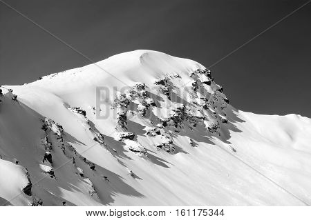 Black and white view on off-piste in winter mountains after snowfall. Mount Cheget. Caucasus Mountains. Elbrus region.
