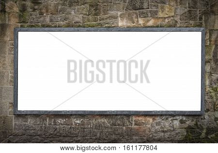 A blank billboard on a stone wall with space to place your own advertising