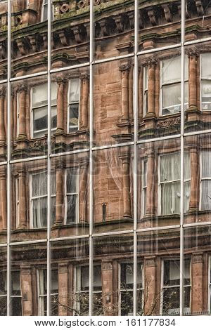 A modern office building in the city centre of Glasgow reflects the vintage red sandstone tenements that once dominated the city.