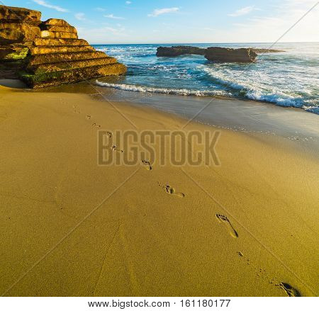 Footsteps in La Jolla beach in California