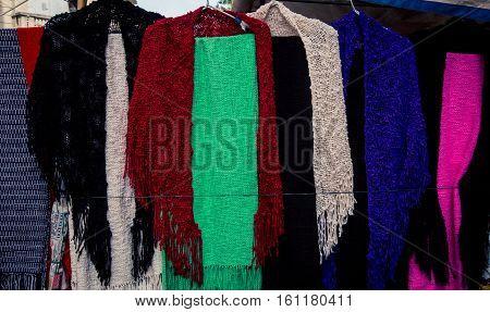 Colorful handmade scarves at the San Telmo market