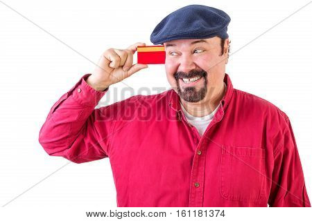Gleeful Man Eyeing His Credit Card With A Smile