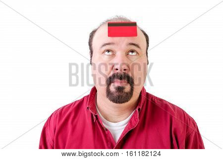 Balding Man With A Bank Card On His Forehead
