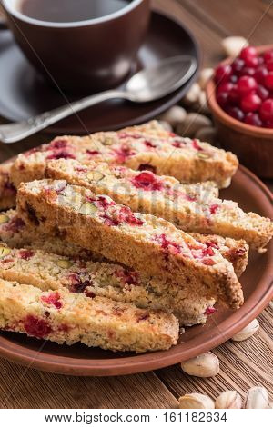 Biscotti with pistachios and cranberries with cup of coffee.