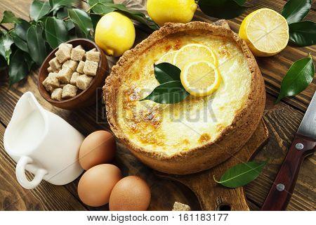 Homemade lemon flan on the wooden table