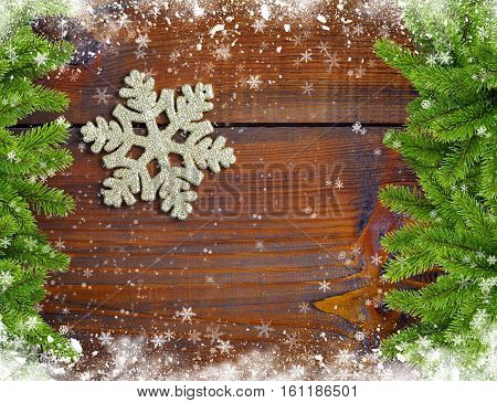 Snowbound Branches Of Spruce And Snowflake Are On An Wooden Background