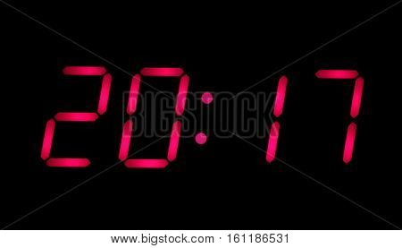 New year time. Big red arabic numerals on electronic watch display shown 2017 isolated on black background horizontal closeup