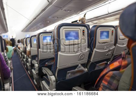 seat space in economy class airplane cabin