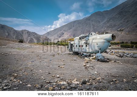 Photo of old destroyed helicopter on rocky ground in Panjshir in Afghanistan.